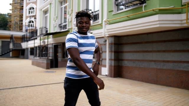 Stylish-african-american-man-dancing-in-city-street