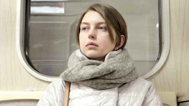Young-woman-goes-by-train-and-listen-music