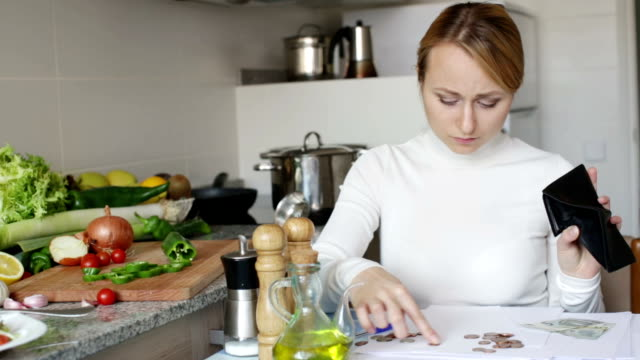 blonde-posing-in-kitchen-with-coins-and-bills