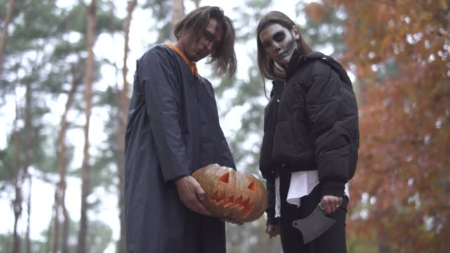 Halloween-The-guy-and-the-girl-with-Halloween-makeup-in-the-forest-