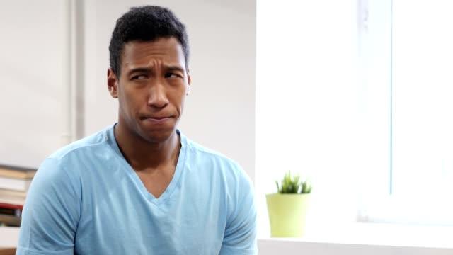 Portrait-of-Upset-Sad-Young-Black-Man