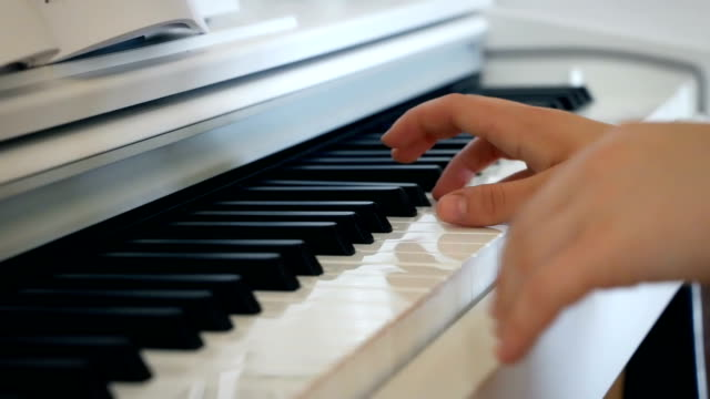 A-musician-plays-the-piano-in-bright-room