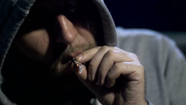 Close-up-male-portrait-smoking-marijuana-cigarette