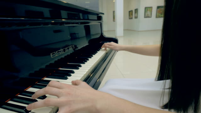 Unrecognised-girl-playing-the-piano-Steadicam-Close-up-4K-