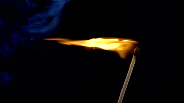 Burning-match-on-a-black-background-in-slow-motion