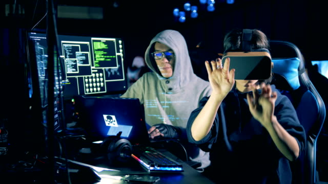 Cyber-crime-and-hacking-concept-Woman-wearing-VR-glasses-while-hacking-computer-close-up-