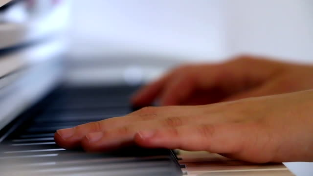 Playing-piano-in-close-up-side-view-stabilized