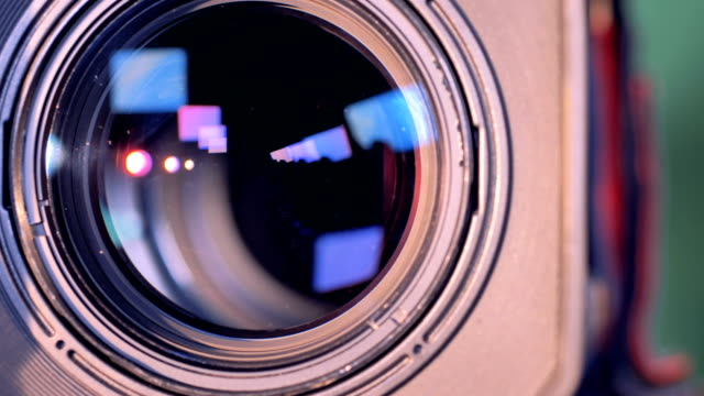 Camera-lens-is-turning-towards-the-viewer-and-is-zooming-out