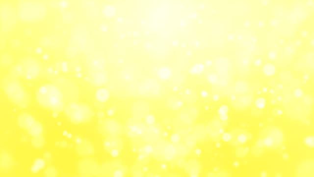 Fondo-de-partículas-amarillo-brillante
