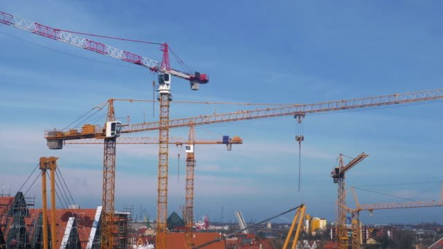 Big-construction-site-with-cranes-panorama-in-4k-slow-motion-60fps