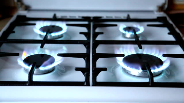 Natural-gas-inflammation-in-stove-burner-close-up-view