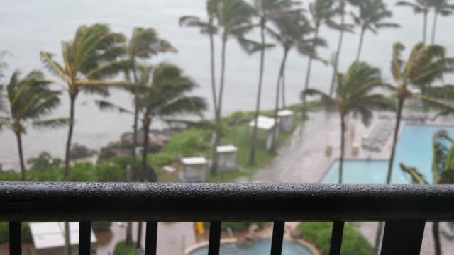 Watching-Rain-collect-on-Hotel-Handrail-During-Hurricane