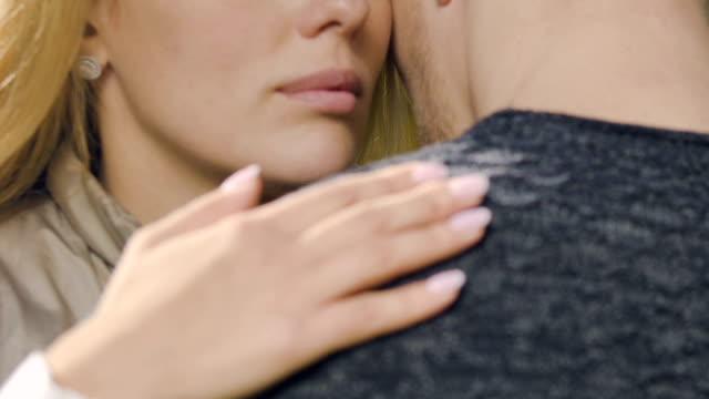 Sad-woman-hugging-man-hard-farewell-before-long-parting-comforting-closeup