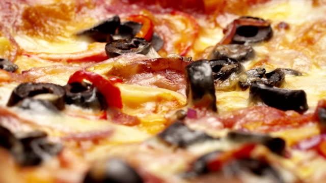 Rustic-italian-pizza-with-pepperoni-mozzarella-and-olive