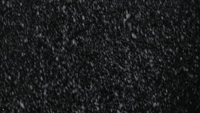 Elemento-de-vfx-Navidad-tormenta-de-nieve-en-la-pantalla-en-negro-