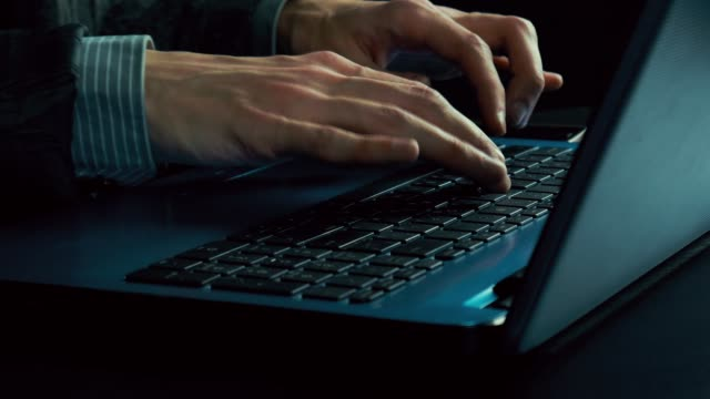 Man-s-hands-typing-text-on-a-laptop