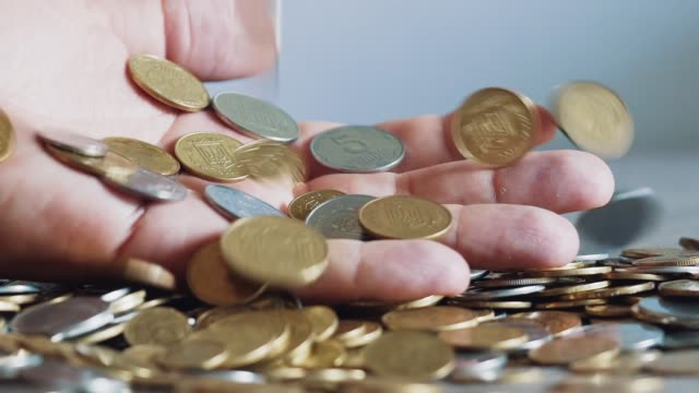 Man-hands-holding-a-lot-of-coins-