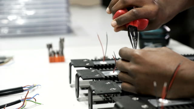 Engineer-working-at-LED-factory