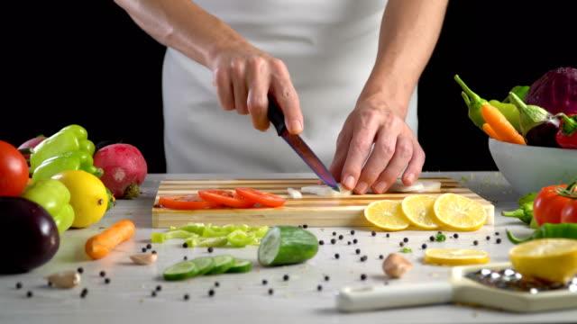 Chef-is-cutting-black-turnip-in-the-kitchen-slicing-black-radish