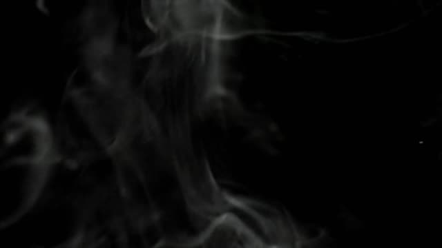 A-real-stream-of-white-steam-on-a-black-isolated-background-rises-to-the-top-Great-for-overlay-in-a-video-editor