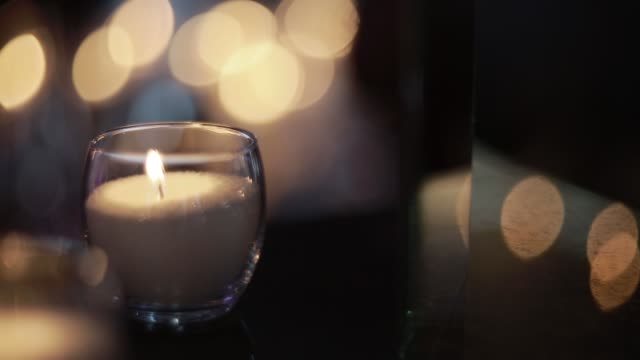candles-burning-in-tall-glass-candlestick-a-restaurant-banquet-decoration-candles-at-the-wedding-table-decorative-candles-are-lit-on-the-festive-table-close-up
