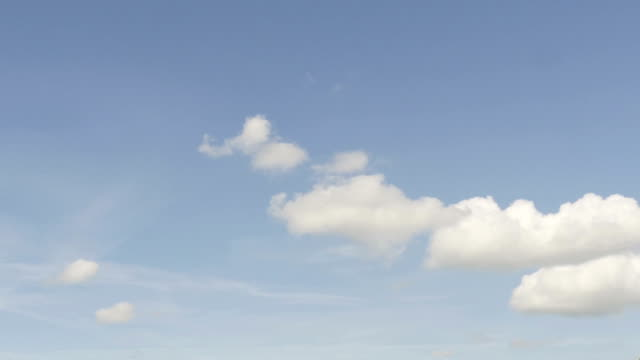 Blue-unclouded-sky-slowly-filling-up-with-rain-clouds-time-lapse-shot