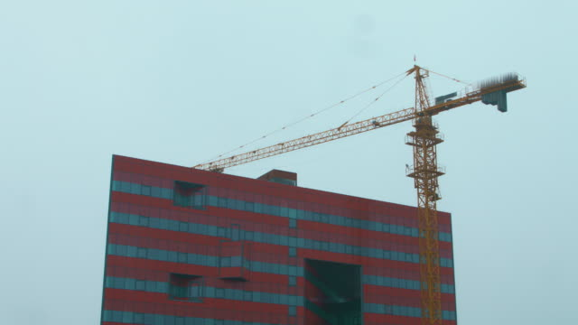 Big-tower-crane-working-on-construction-site-Heavy-machinery-on-building-site