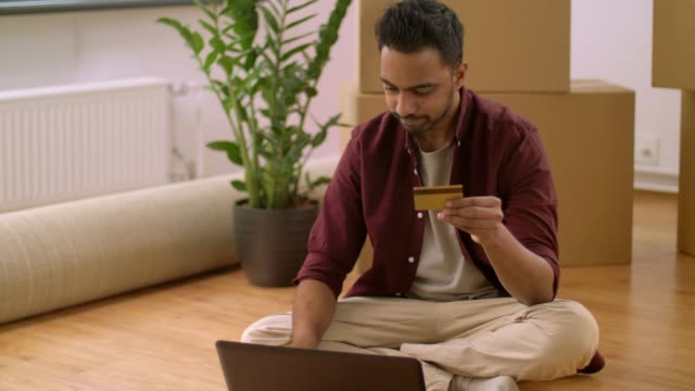 man-with-laptop-shopping-online-at-new-home