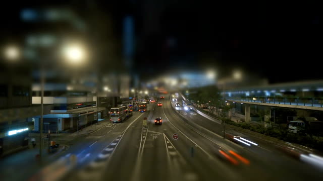 Street-traffic-at-night-modern-urban-landscape-and-the-bustling-streets