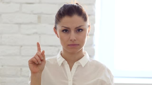 Shaking-Head-to-Reject-Woman-Sitting-in-Office