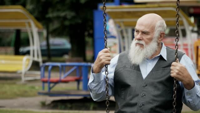Sad-senior-man-swings