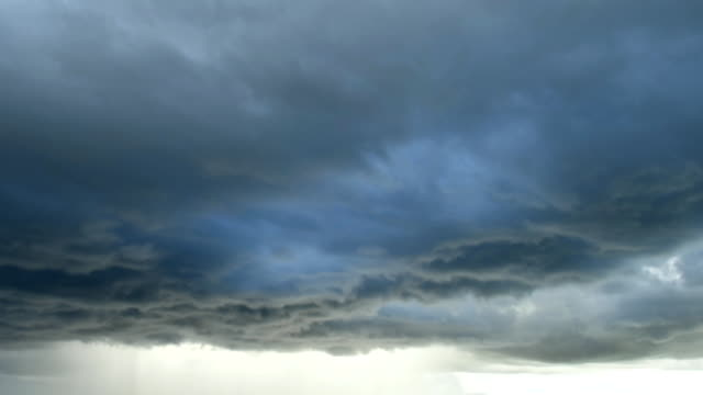 Light-in-the-Dark-and-Dramatic-Storm-Clouds-background-Black-cumulus-clouds-before-the-beginning-of-a-strong-storm