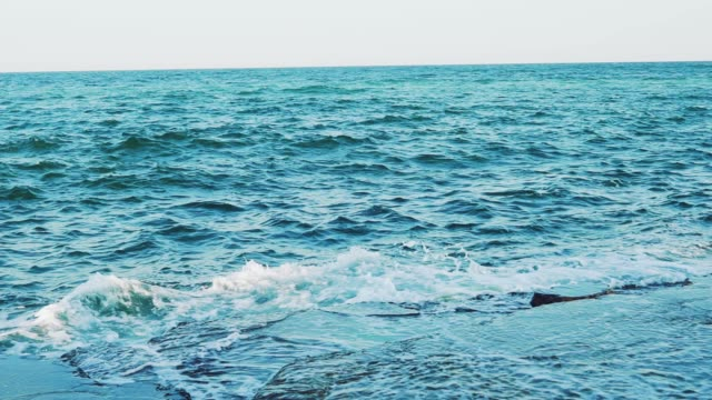 Crests-of-the-waves-are-breaking-on-the-reefs-near-the-shore-in-the-summer-