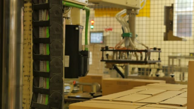 Folding-cardboard-boxes-on-a-conveyor-belt-in-a-rice-factory-–-4K
