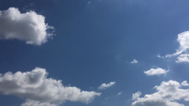 White-cloud-disappear-in-the-hot-sun-on-blue-sky-Cumulus-clouds-form-against-a-brilliant-blue-sky-Time-lapse-motion-clouds-blue-sky-background-