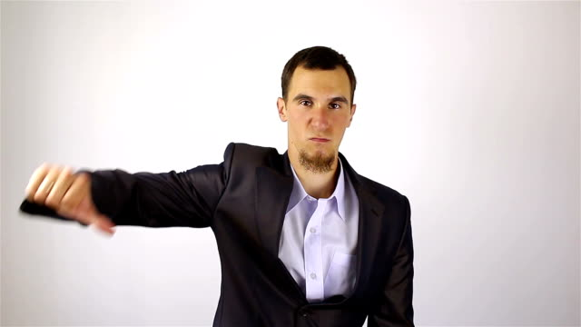 Sad-businessman-with-a-beard-showing-dislajk