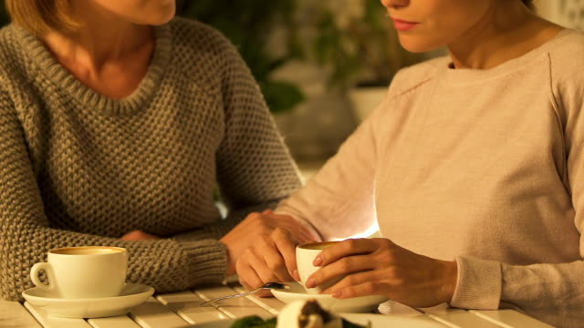 Women-chatting-over-cup-of-coffee-supporting-in-difficulty-female-friendship