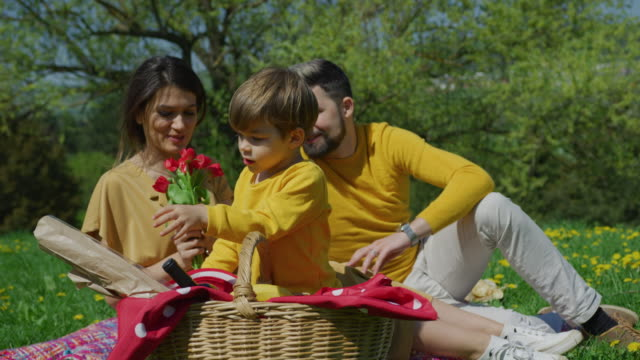 Boy-taking-out-things-from-picnic-basket