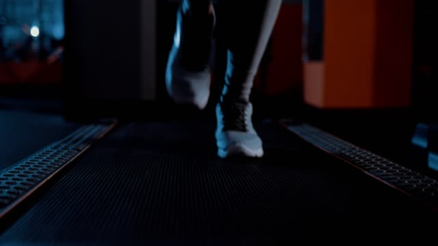 Running-in-sneakers-on-a-treadmill-Legs-close-up