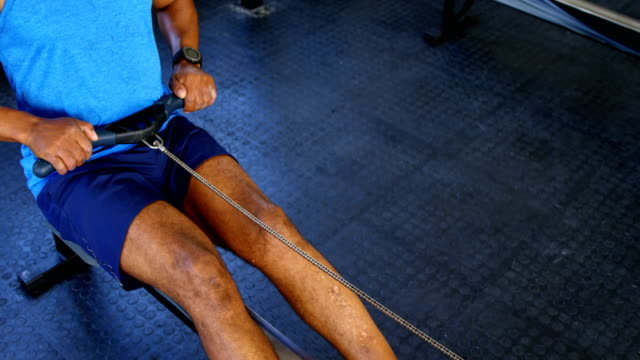 Senior-man-working-out-on-rowing-machine-4k