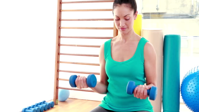 Young-woman-exercising-with-dumbbells