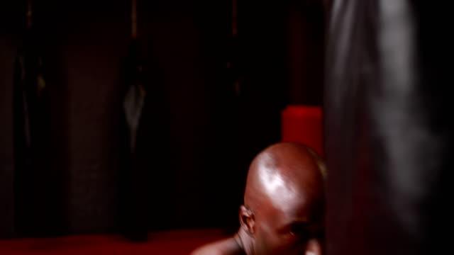 Man-boxing-at-gym-gym