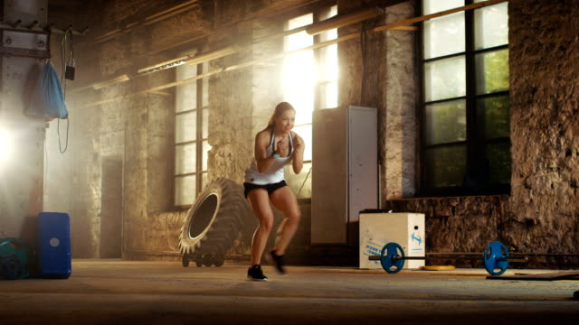 Fit-Athletic-Woman-Does-Footwork-Running-Drill-in-a-Deserted-Factory-Remodeled-into-Gym-Fitness-Exercise/-Workout-Aimed-at-Strengthening-Legs-Enhancing-Her-Agility-and-Speed-