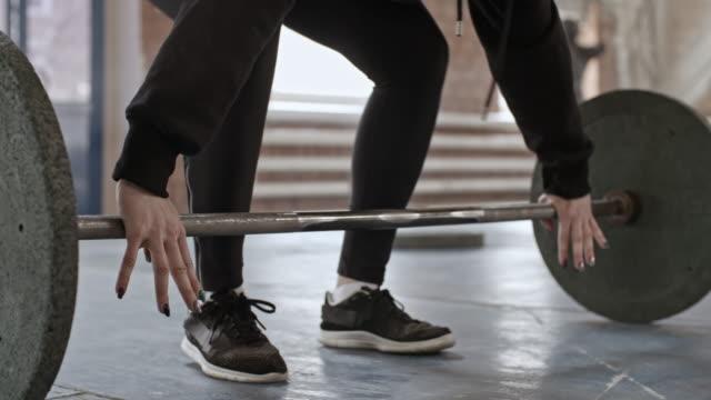 Female-Athlete-Doing-Reverse-Grip-Barbell-Curl