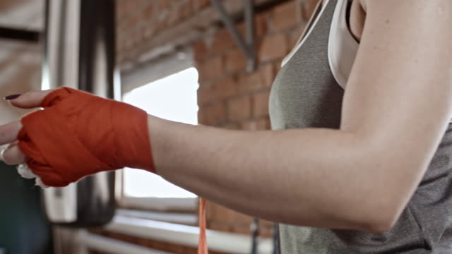 Female-Boxer-Wrapping-Hands-with-Bandage