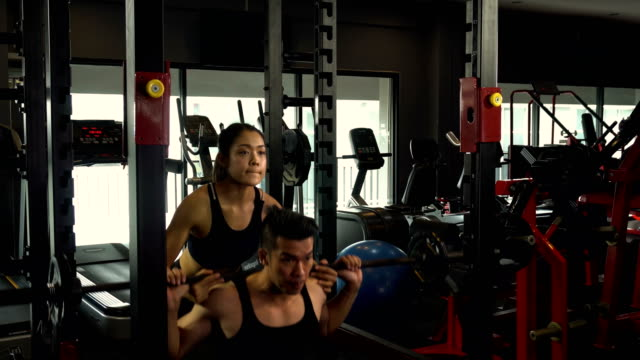 Exercise-in-the-gym-man-and-women-want-to-have-a-beautiful-body-with-fitness-