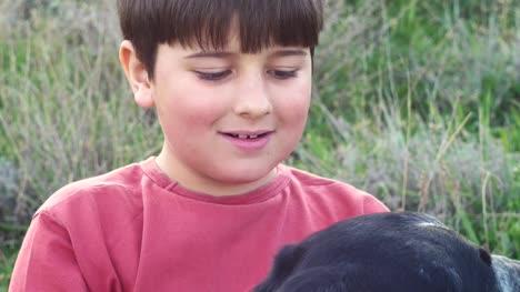 the-boy-caresses-the-dog