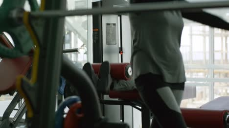 Grey-Haired-Man-Training-in-Gym