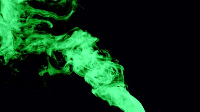 green-smoke-isolated-on-dark-screen