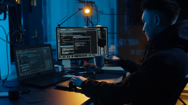 hacker-using-computer-for-cyber-attack-at-night